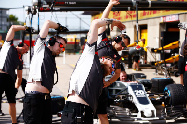 Circuit Gilles Villeneuve, Montreal, Canada. Thursday 08 June 2017. Haas team members loosen up by taking exercises. World Copyright: Andy Hone/LAT Images ref: Digital Image _ONY2567