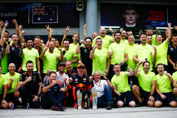 Sepang International Circuit, Sepang, Malaysia. Sunday 1 October 2017. Max Verstappen, Red Bull, 1st Position, Daniel Ricciardo, Red Bull Racing, 3rd Position, Christian Horner, Team Principal, Red Bull Racing, Helmut Markko, Consultant, Red Bull Racing, and the Red Bull team celebrate. World Copyright: Andrew Hone/LAT Images  ref: Digital Image _ONZ0500