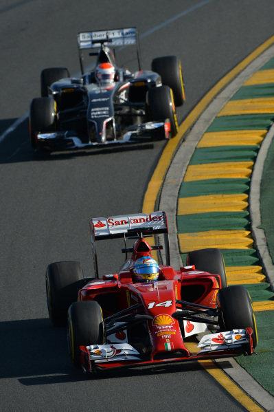 Fernando Alonso (ESP) Ferrari F14 T and Adrian Sutil (GER) Sauber C33. Formula One World Championship, Rd1, Australian Grand Prix, Practice, Albert Park, Melbourne, Australia, Friday 14 March 2014.