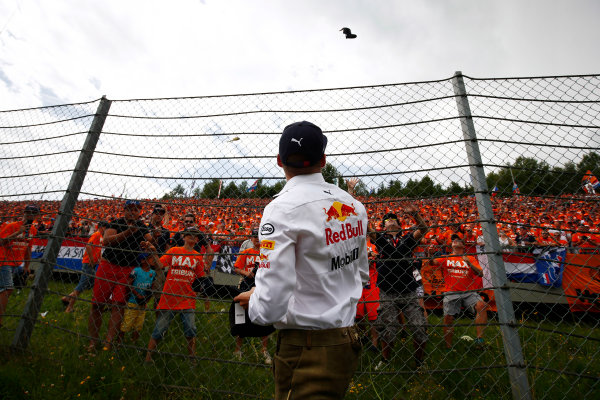 Red Bull Ring, Spielberg, Austria. Sunday 09 July 2017. Max Verstappen, Red Bull Racing, throws a cap into a crowd of Dutch fans World Copyright: Andy Hone/LAT Images ref: Digital Image _ONY2418