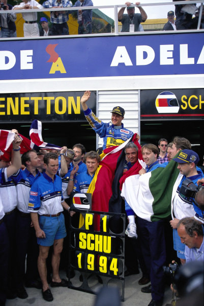 Michael Schumacher celebrates his first F1 championship with his Benetton team.