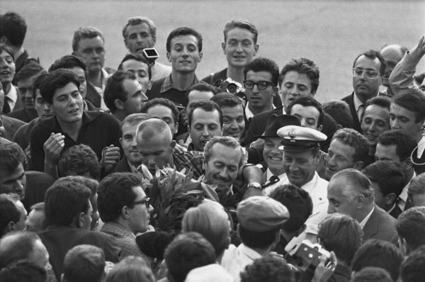 Monza, Italy. 6th - 8th September 1963.  Jim Clark (Lotus 25 Climax), 1st position with team boss Colin Chapman as they celebrate finishing in 1st position and clinching the drivers and constructors World Championship titles, portrait. World Copyright: LAT Photographic. Ref: L63 - 282 - 33.