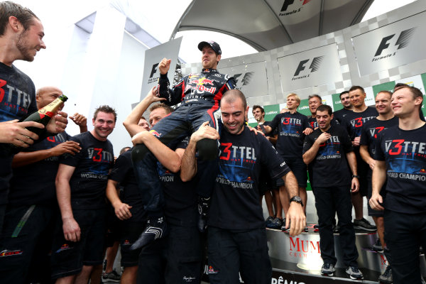 Interlagos, Sao Paulo, Brazil. Sunday 25th November 2012. Sebastian Vettel, Red Bull Racing, 2012 F1 World Champion, celebrates with his team. World Copyright:Andy Hone/LAT Photographic ref: Digital Image HONZ3875