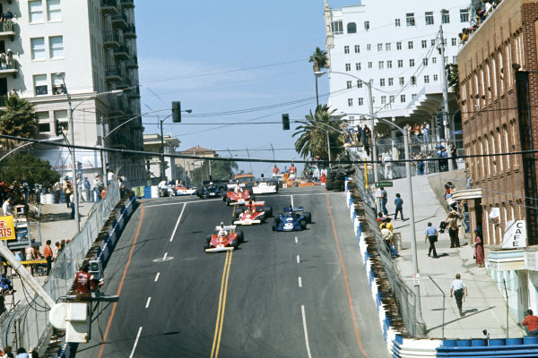 Long Beach, California, USA. 26 - 28 March 1976. Clay Regazzoni (Ferrari 312T ), 1st position, leads at the start, action.  World Copyright: LAT Photographic. Ref:  76LB24