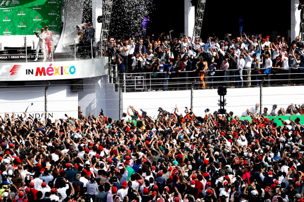 Autodromo Hermanos Rodriguez, Mexico City, Mexico. Sunday 30 October 2016. Lewis Hamilton, Mercedes AMG, 1st Position, Nico Rosberg, Mercedes AMG, 2nd Position, and Sebastian Vettel, Ferrari, 3rd Position, celebrate on the podium after the race. World Copyright: Glenn Dunbar/LAT Photographic ref: Digital Image _31I0023