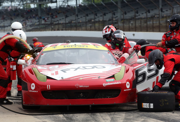 25-26 July, 2013, Indianapolis, Indiana, USA The #69 Ferrari of Emil Assentato and Anthony Lazzaro  makes pit stop. ©2013, R.D. Ethan LAT Photo USA