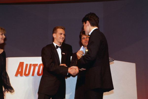 1992 Autosport Awards. Grosvenor House Hotel, Park Lane, London. 6th December 1992. Dario Franchitti wins the Autosport Young Driver of the Year award, presented by Michael Andretti with Autosport Editor, Andy Hallbery, portrait.  World Copyright: LAT Photographic. Ref:  Colour Transparency.