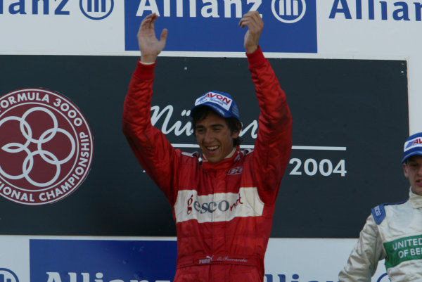 2004 Formula 3000 Championship (F3000) Nurburgring, Germany.29th May 2004. Winner Enrico Toccacelo (BCN F3000) on the podium.World Copyright: LAT Photographic ref: Digital Image Only