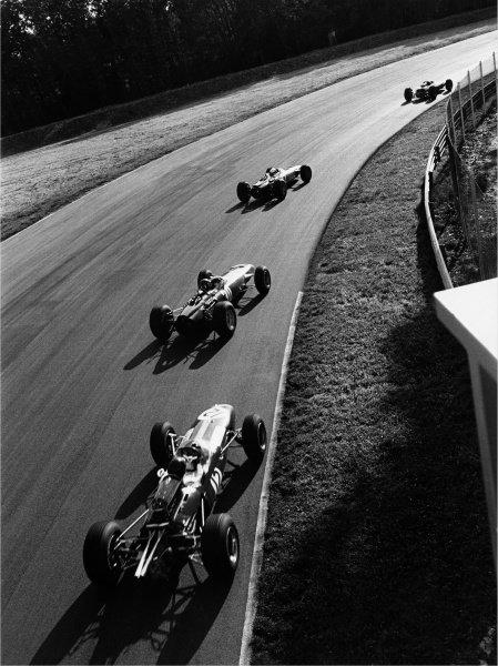 1965 Italian Grand Prix.  Monza, Italy. 10-12 September 1965. Jim Clark, Jackie Stewart, Graham Hill and Dan Gurney drift through the Parabolica. World Copyright - LAT Photographic Ref: 204G/5-5A