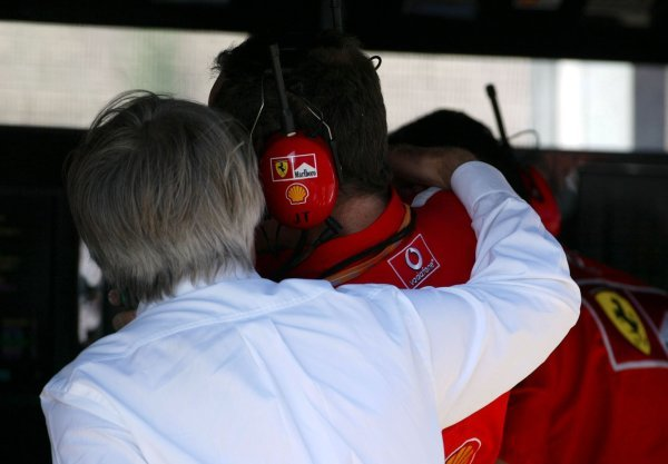 (L to R): Bernie Ecclestone (GBR) F1 Supremo has a quiet word in the ear of Jean Todt (FRA) Ferrari General Manager.