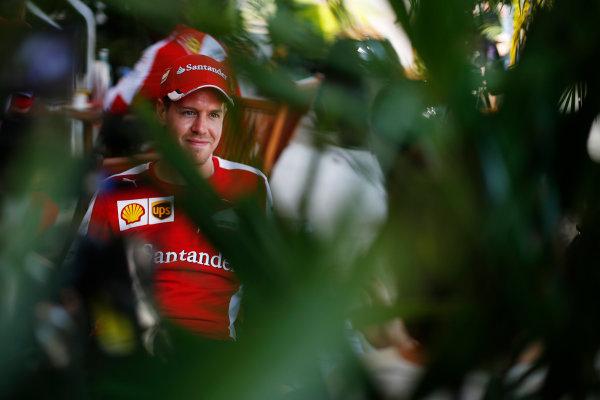 Sepang International Circuit, Sepang, Kuala Lumpur, Malaysia. Thursday 26 March 2015. Sebastian Vettel, Ferrari, in the Paddock. World Copyright: Steven Tee/LAT Photographic. ref: Digital Image _L4R3085