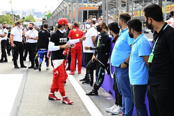 Carlos Sainz, Ferrari and Sir Lewis Hamilton, Mercedes