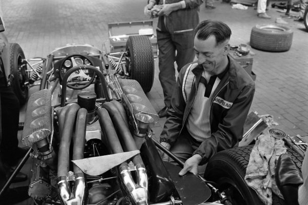Ron Tauranac, engineer and designer, works on the car of Denny Hulme, Brabham BT19 Repco, retired.