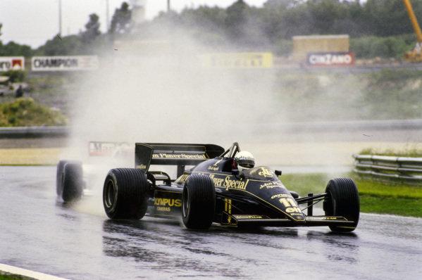 Elio de Angelis, Lotus 97T Renault, leads Alain Prost, McLaren MP4-2B TAG.