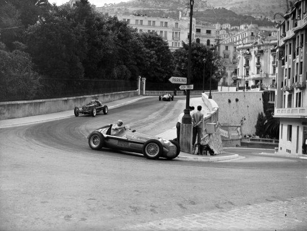 Juan Manuel Fangio, Alfa Romeo 158, leads Bob Gerard, ERA A.