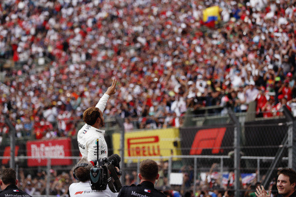 Lewis Hamilton, Mercedes AMG F1, celebrates with the fans after winning his fifth World Championship