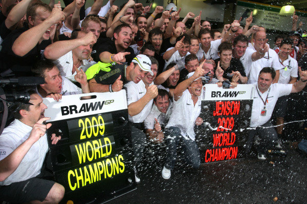 The Brawn GP team celebrates their constructor'ss title and Jenson Button's drivers world championship in the pit lane.