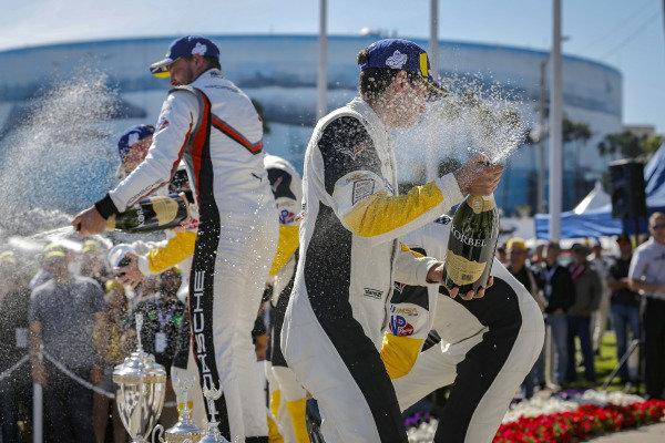 #4 Corvette Racing Corvette C7.R, GTLM: Oliver Gavin, Tommy Milner, #912 Porsche GT Team Porsche 911 RSR, GTLM: Earl Bamber, Laurens Vanthoor, #3 Corvette Racing Corvette C7.R, GTLM: Jan Magnussen, Antonio Garcia celebrate on the podium with champagne