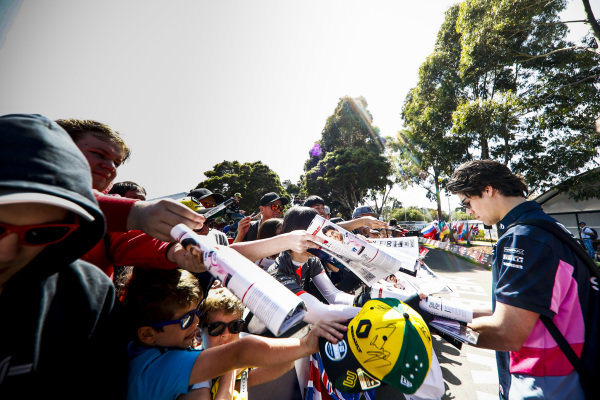 Lance Stroll, Racing Point hand signs autographs for fans