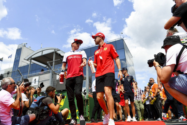 Kimi Raikkonen, Alfa Romeo Racing, and Sebastian Vettel, Ferrari, in the drivers parade