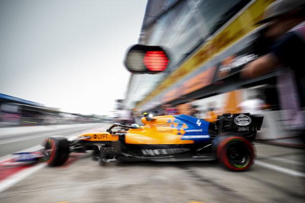 Lando Norris, McLaren MCL34, leaves the garage