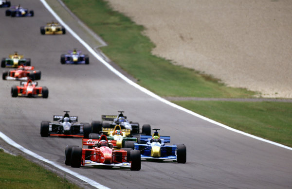 2001 International F3000Nurburgring, Germany. 22nd - 23rd June 2001.Race winner Thomas Enge, Nordic Racing, leads from Mark Webber ( Super Nova) at the start of the race.World Copyright: Charles Coates/LAT Photographicref: 35mm Image A12