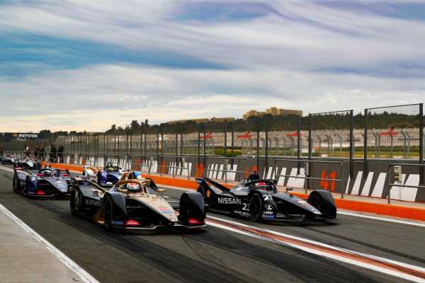 Jean-Eric Vergne (FRA), DS Techeetah, DS E-Tense FE20, and Sébastien Buemi (CHE), Nissan e.Dams, Nissan IMO2 side by side in the pit lane