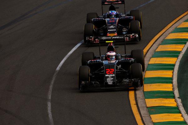 Albert Park, Melbourne, Australia. Sunday 20 March 2016. Jenson Button, McLaren MP4-31 Honda, leads Max Verstappen, Toro Rosso STR11 Ferrari. World Copyright: Charles Coates/LAT Photographic ref: Digital Image _W7W1062