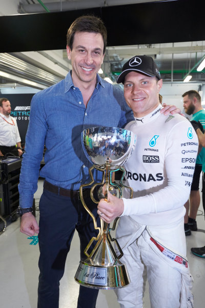 Sochi Autodrom, Sochi, Russia. Sunday 30 April 2017. Toto Wolff, Executive Director (Business), Mercedes AMG, and Valtteri Bottas, Mercedes AMG, 1st Position, with his trophy. World Copyright: Steve Etherington/LAT Images ref: Digital Image SNE14847