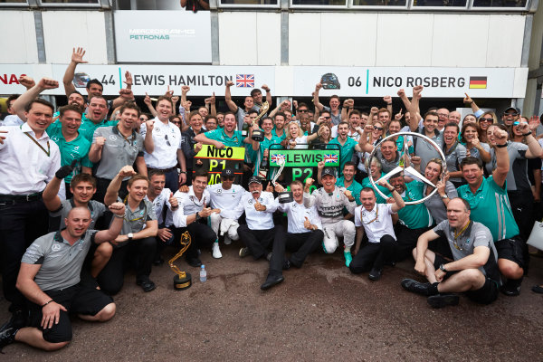 Monte Carlo, Monaco. Sunday 25 May 2014. Nico Rosberg, Mercedes AMG, 1st Position, Lewis Hamilton, Mercedes AMG, 2nd Position, Toto Wolff, Executive Director (Business), Mercedes AMG, Dr Dieter Zetsche, CEO, Mercedes Benz, Paddy Lowe, Executive Director (Technical), Mercedes AMG, and the Mercedes AMG team celebrate. World Copyright: Steve Etherington/LAT Photographic. ref: Digital Image SNE20214 copy
