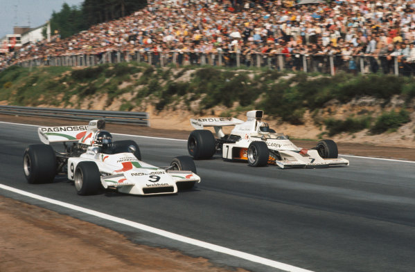 1973 Belgian Grand Prix.  Zolder, Belgium. 18-20th May 1973.  Andrea de Adamich, Brabham BT37 Ford, 4th position, alongside Denny Hulme, McLaren M23 Ford, 7th position.  Ref: 73BEL67. World Copyright: LAT Photographic