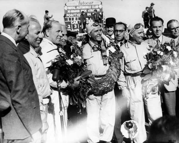 Silverstone, England.11-13 May 1950.The Alfa Romeo team of Giuseppe Farina (centre), Luigi Fagioli (right) and Reg Parnell (left) celebrate finishing in 1st, 2nd and 3rd positions respectively.Published-Autocar 19/5/1950 p592.World Copyright - LAT Photographic