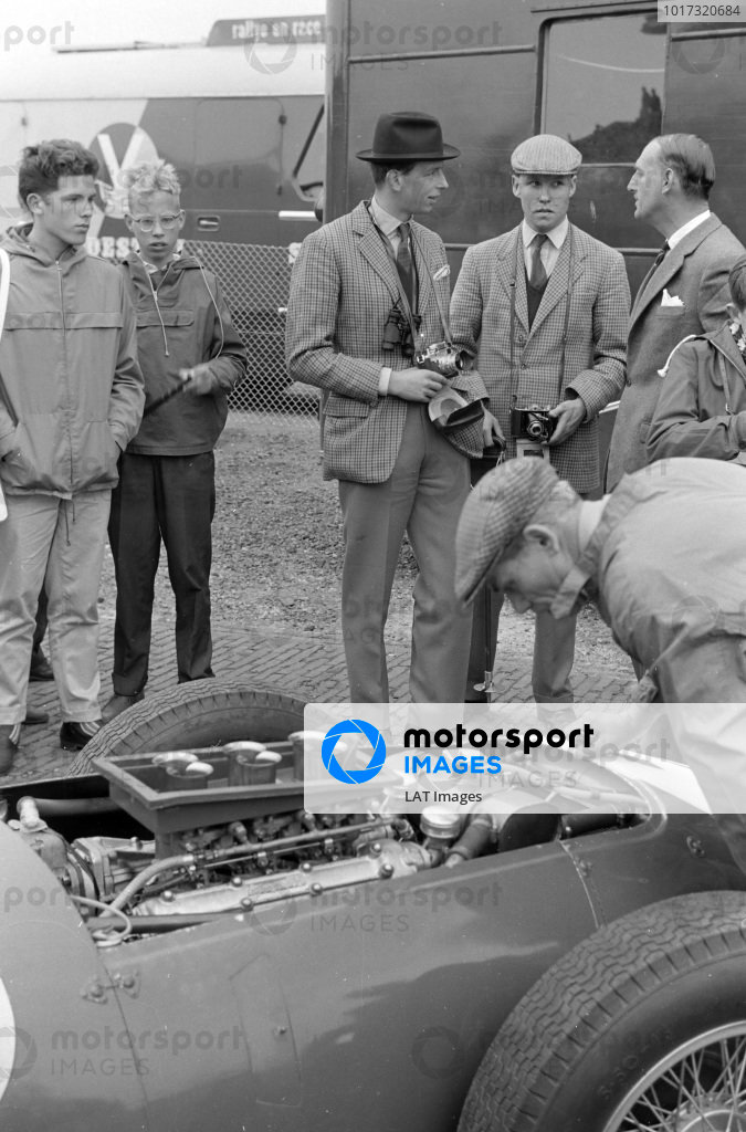 A very young Prince Edward, Duke of Kent, photographs the Aston Martin cars in the paddock.