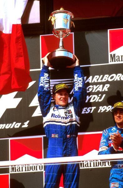 Hungaroring, Budapest, Hungary.9-11 August 1996.Jacques Villeneuve (Williams Renault) 1st position celebrates on the podium.Ref-96 HUN 02.World Copyright - LAT Photographic