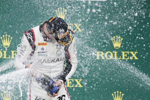 Race winner Leonardo Pulcini (ITA) Hitech Grand Prix celebrates on the podium with the champagne