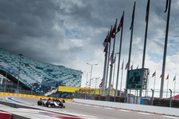Kimi Raikkonen, Alfa Romeo Racing C38, leads Lando Norris, McLaren MCL34