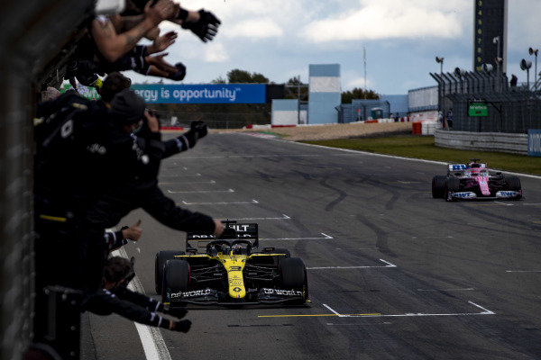 Daniel Ricciardo, Renault R.S.20, is greeted by his team at the finish, ahead of Sergio Perez, Racing Point RP20. This was Renault's first podium since the team's return to Formula 1