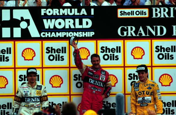 1987 British Grand Prix.Silverstone, England.10-12 July 1987.Nigel Mansell, Nelson Piquet (both Williams Honda) and Ayrton Senna (Team Lotus) after finishing in 1st, 2nd and 3rd positions respectively.World Copyright - LAT Photographic