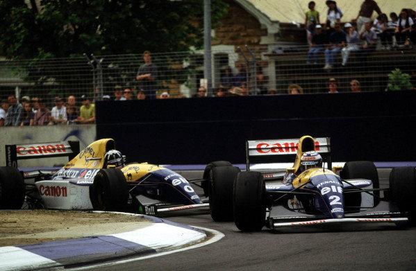 1993 Australian Grand Prix.Adelaide, Australia.5-7 November 1993.Alain Prost leads teammate Damon Hill (both Williams FW15C Renault's).World Copyright - LAT Photographic