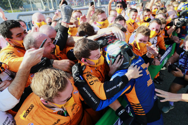 Daniel Ricciardo, McLaren, 1st position, celebrates in Parc Ferme with his team