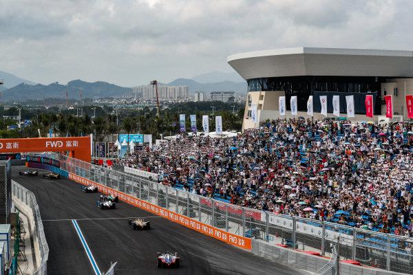 Oliver Rowland (GBR), Nissan e.Dams, Nissan IMO1, leads Jean-Eric Vergne (FRA), DS TECHEETAH, DS E-Tense FE19, Antonio Felix da Costa (PRT), BMW I Andretti Motorsports, BMW iFE.18, Daniel Abt (DEU), Audi Sport ABT Schaeffler, Audi e-tron FE05, Alexander Sims (GBR) BMW I Andretti Motorsports, BMW iFE.18, Andre Lotterer (DEU), DS TECHEETAH, DS E-Tense FE19, and Jérôme d'Ambrosio (BEL), Mahindra Racing, M5 Electro
