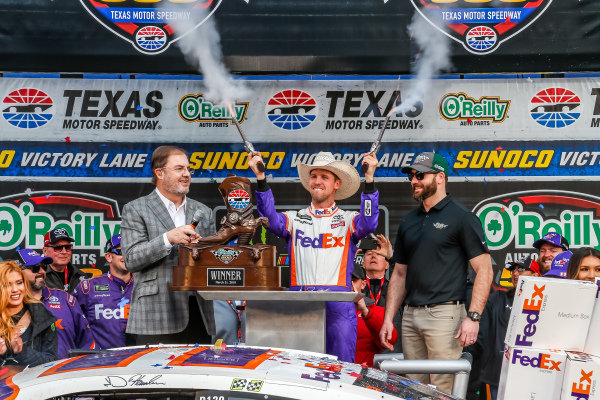 #11: Denny Hamlin, Joe Gibbs Racing, Toyota Camry FedEx Office victory lane revolvers