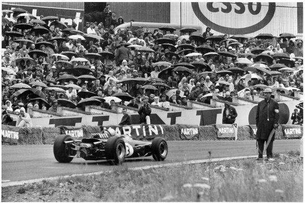 1966 Belgian Grand Prix.Spa-Francorchamps, Belgium. 12 June 1966.Jack Brabham (Brabham BT19-Repco), 4th position, at Eau Rouge in the rain.World Copyright: LAT PhotographicRef: black & white/MotorSport calendar