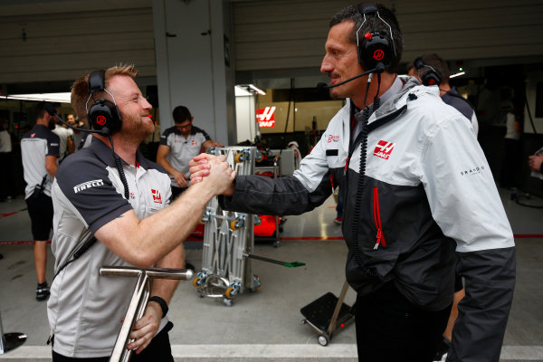 Suzuka Circuit, Japan. Saturday 8 October 2016. Guenther Steiner, Team Principal, Haas F1, and the Haas F1 engineers celebrate a successful qualifying session. World Copyright: Andrew Hone/LAT Photographic ref: Digital Image _ONZ4699