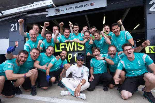 Silverstone, Northamptonshire, UK Sunday 10 July 2016. Lewis Hamilton, Mercedes AMG, 1st Position, and the Mercedes team celebrate victory. World Copyright: Steve Etherington/LAT Photographic ref: Digital Image SNE13494