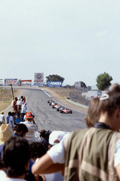 1981 Spanish Grand PrixJarama, Spain. 19th - 21st June.Gilles Villeneuve (Ferrari) leads a train of cars as the crowd watches. Action.World Copyright: LAT Photographicref: 81 ESP 15