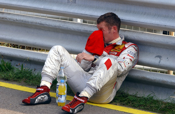 2004 DTM ChampionshipZandvoort, Netherlands. 4th - 5th September.Tom Kristensen (Abt Sportsline Audi A4) waits to hear news of Peter Dumbreck's condition after his huge accident. Portrait.World Copyright: Andre Irlmeier/LAT Photographicref: Digital Image Only