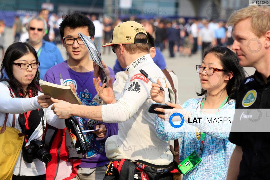 Shanghai International Circuit, Shanghai, China Saturday 13th April 2013 Kimi Raikkonen, Lotus F1, signs autographs for fans.  World Copyright: Charles Coates/LAT Photographic ref: Digital Image _X5J0945