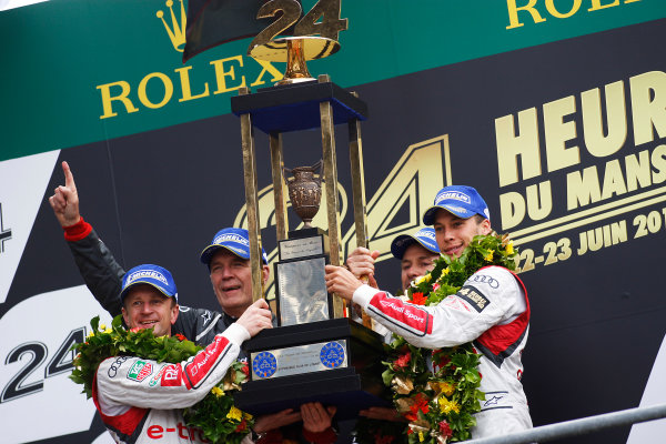 Circuit de La Sarthe, Le Mans, France. 21st-23rd June 2013. Tom Kristensen/Loic Duval/Allan McNish, Audi Sport Team Joest, No 2 Audi R18 e-tron quattro celebrate win with Wolfgang Ullrich. World Copyright: Sam Bloxham/LAT Photographic ref: Digital Image _LOX9587