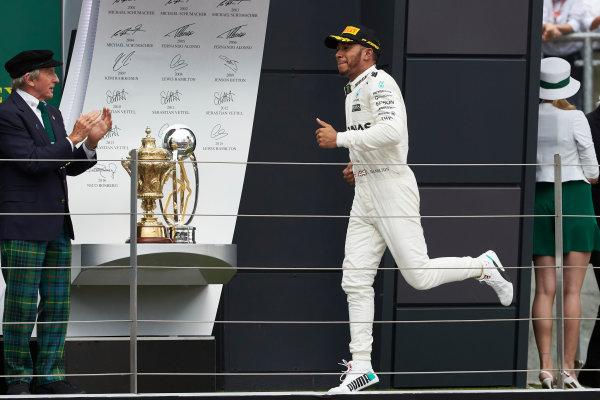 Silverstone, Northamptonshire, UK.  Sunday 16 July 2017. Valtteri Bottas, Mercedes AMG, and Sir Jackie Stewart, 3-time F1 Champion, on the podium. World Copyright: Steve Etherington/LAT Images  ref: Digital Image SNE19841